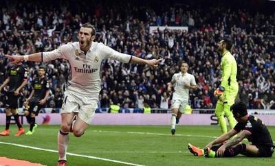 Bale reaparece con gol para asegurar el liderato del Madrid