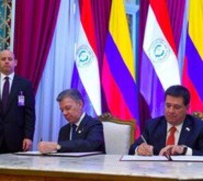 Cartes y Santos hablan sobre temas comerciales y de defensa