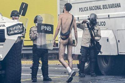 Once muertos tras violentos disturbios en Caracas