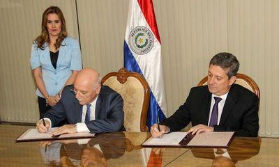 Firman convenio para elecciones en el exterior