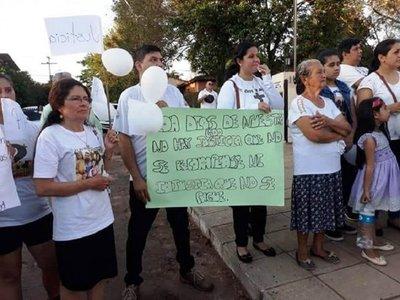 Marcharon para exigir justicia por asesinato de policía y su familia