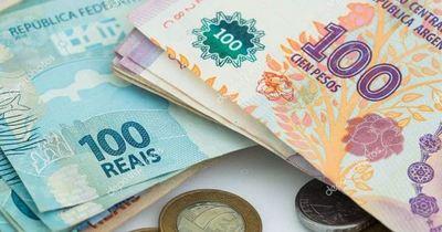 Argentina y Brasil negocian la creación de una moneda común