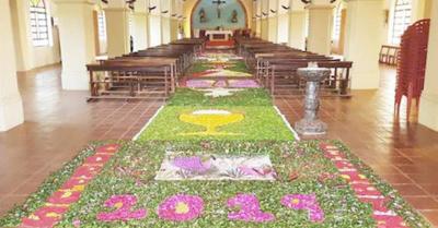 Armaron alfombra  de flores de unos 40 metros