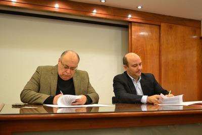 Suscripción de convenio marco entre el MITIC y la UNE