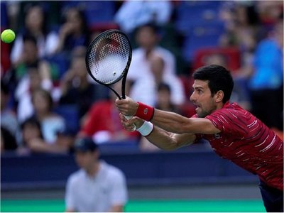 Djokovic y Federer pasan a cuartos