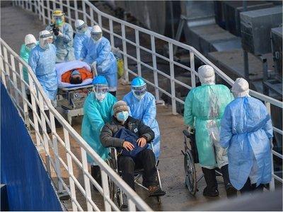 China pide calma mientras intenta revertir propagación de coronavirus